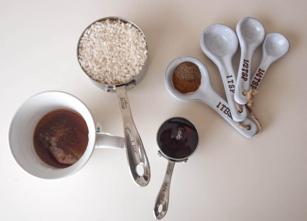 Ingredients For Coconut Maple Chai Breakfast Risotto in measuring cups & spoons.