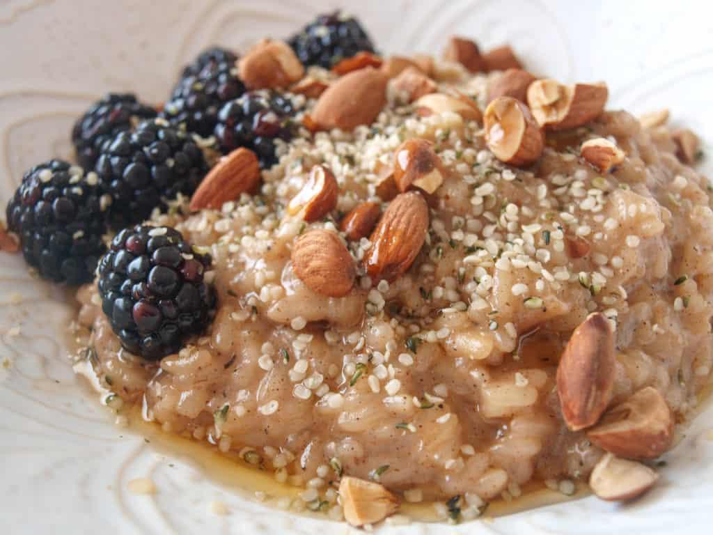 Coconut Maple Chai Breakfast Risotto in a white bowl.