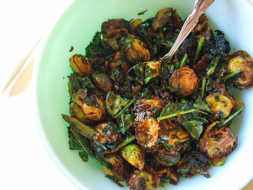 Maple Lime Fried Brussels Sprouts & Kale in a light green bowl.