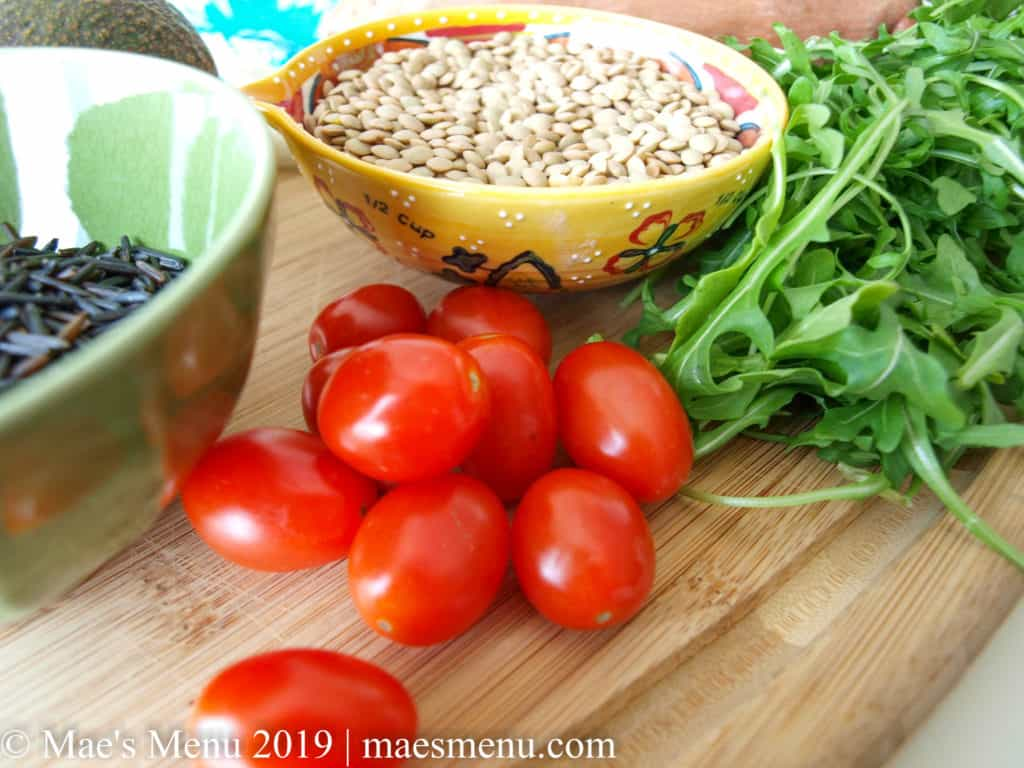Ingredients For Healthy Lentil Bowl with Sweet potatoes: lentils, rice, baby tomatoes, arugula, and more.