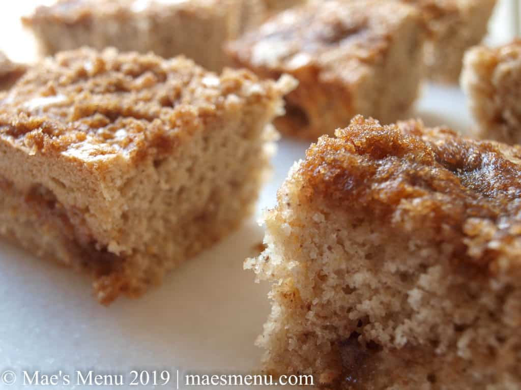 Pieces of coffee cake sitting on white granite countertop.