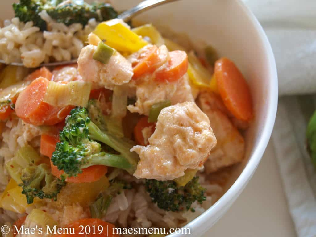 Thai Salmon Panang Curry in a white bowl over rice.