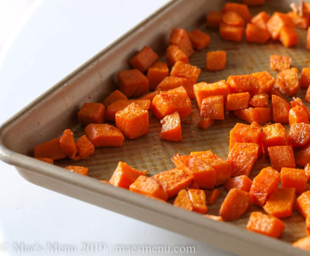 A sheet of roasted sweet potato cubes.