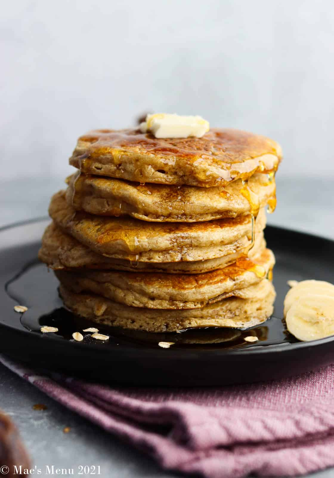 An up-close shot of a stack of oatmeal blender pancakes