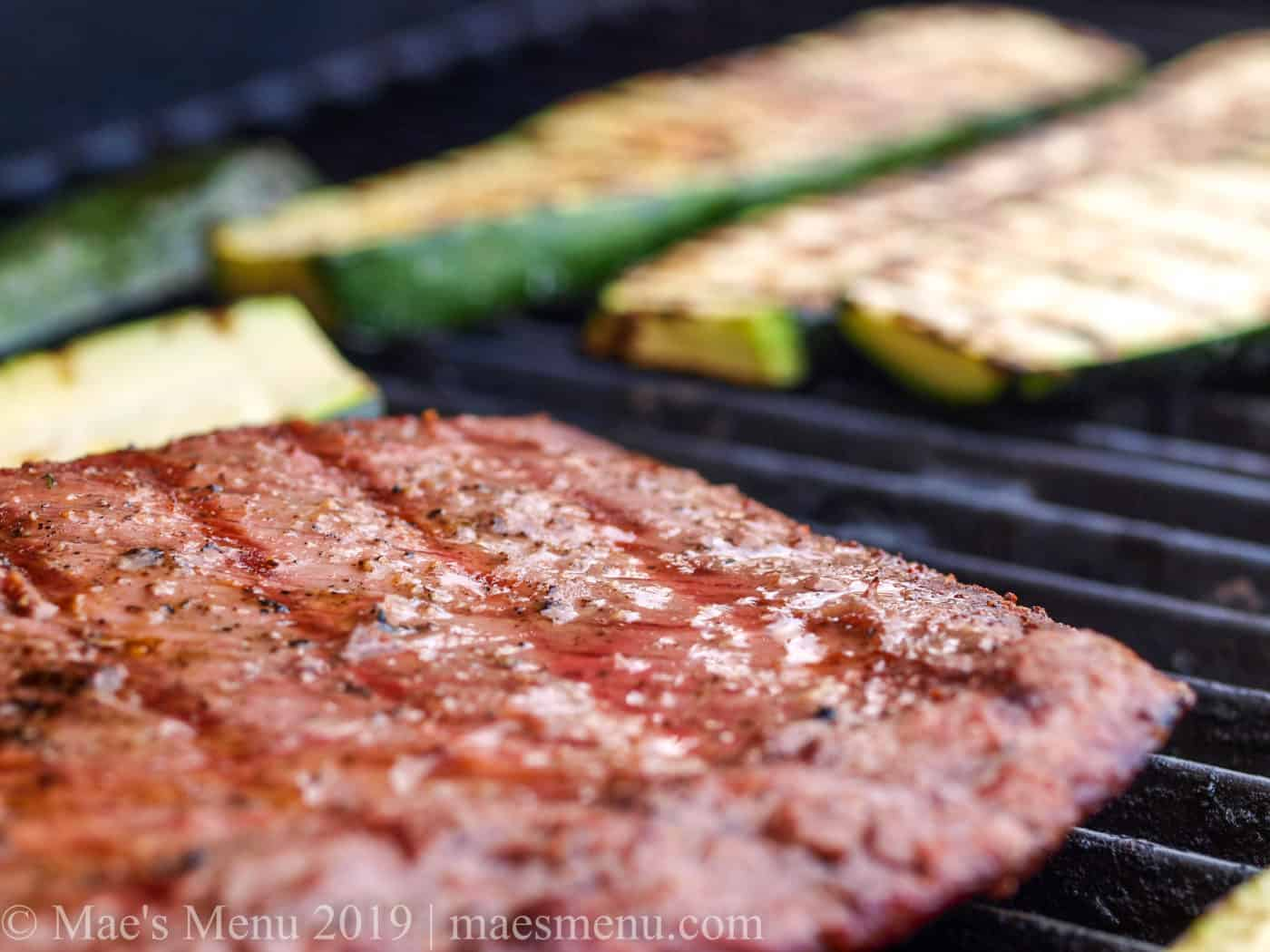 Grilling steak and zucchini.