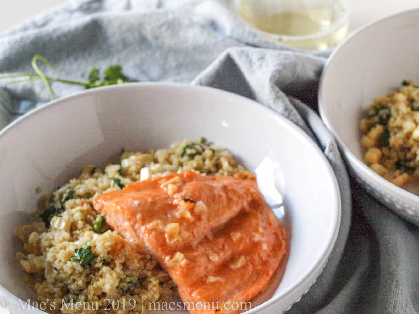 Two bowls of easy baked salmon with fresh corn & quinoa salad.