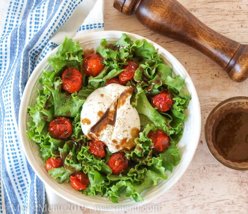 Overhead shot of roasted tomato salad with burrata.