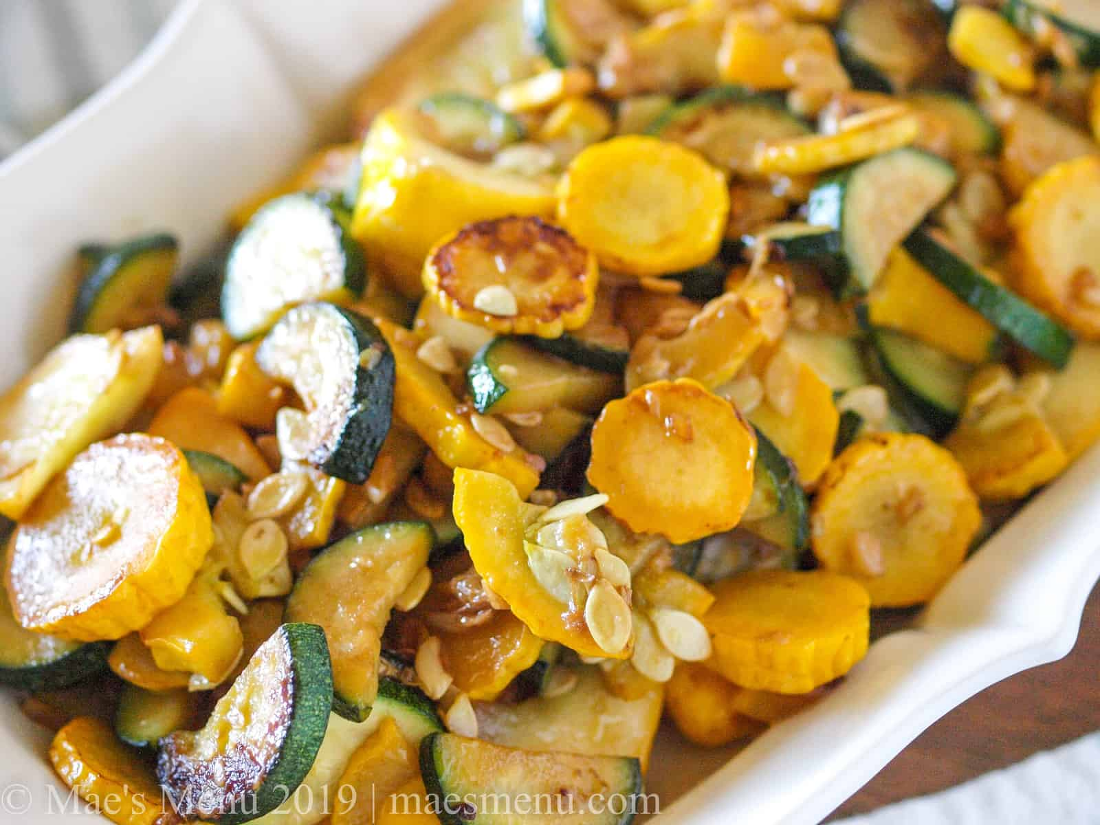 Large bowl of sauteed zucchini and yellow squash.