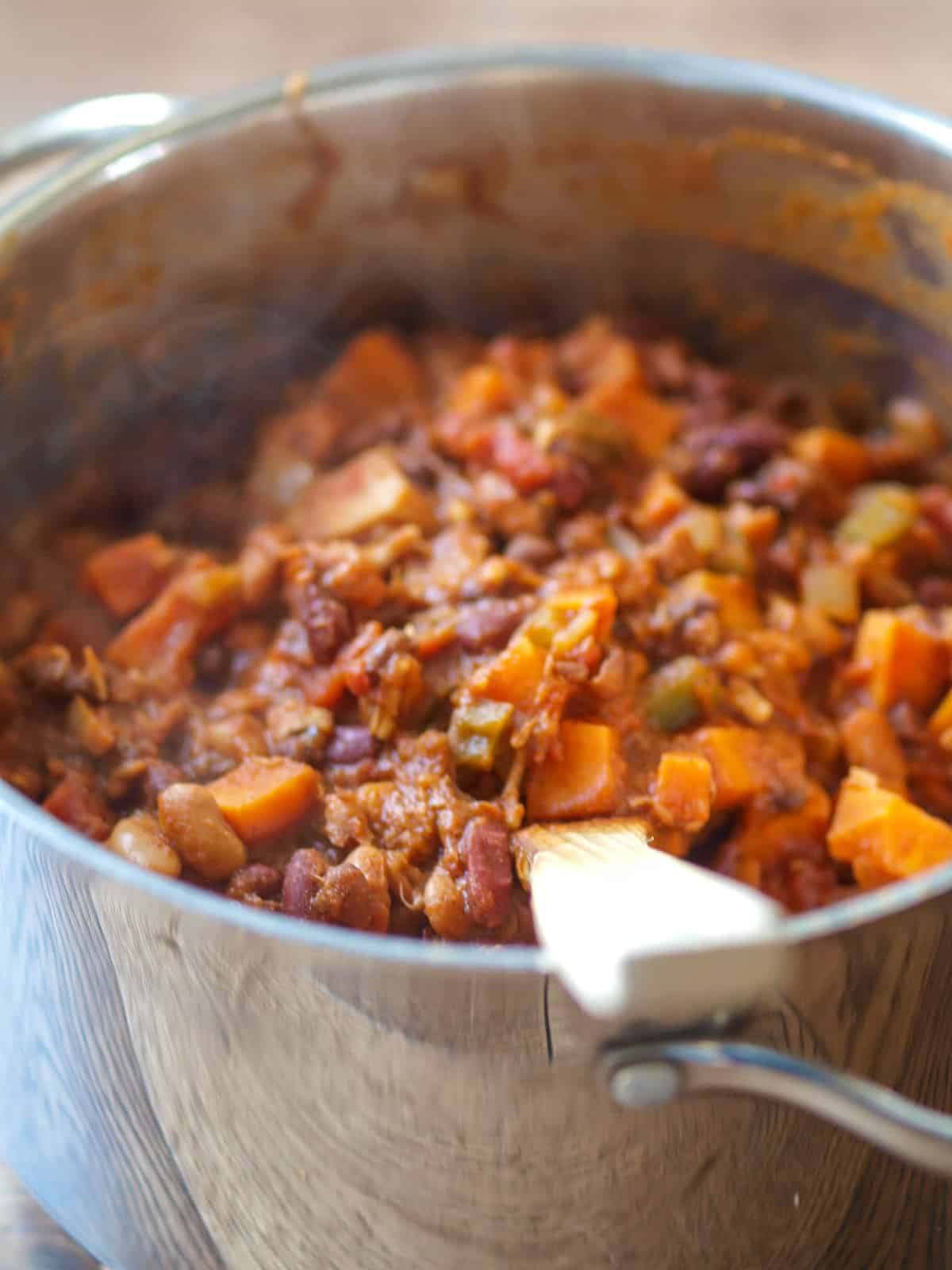 A large, steaming pot of vegan chili.
