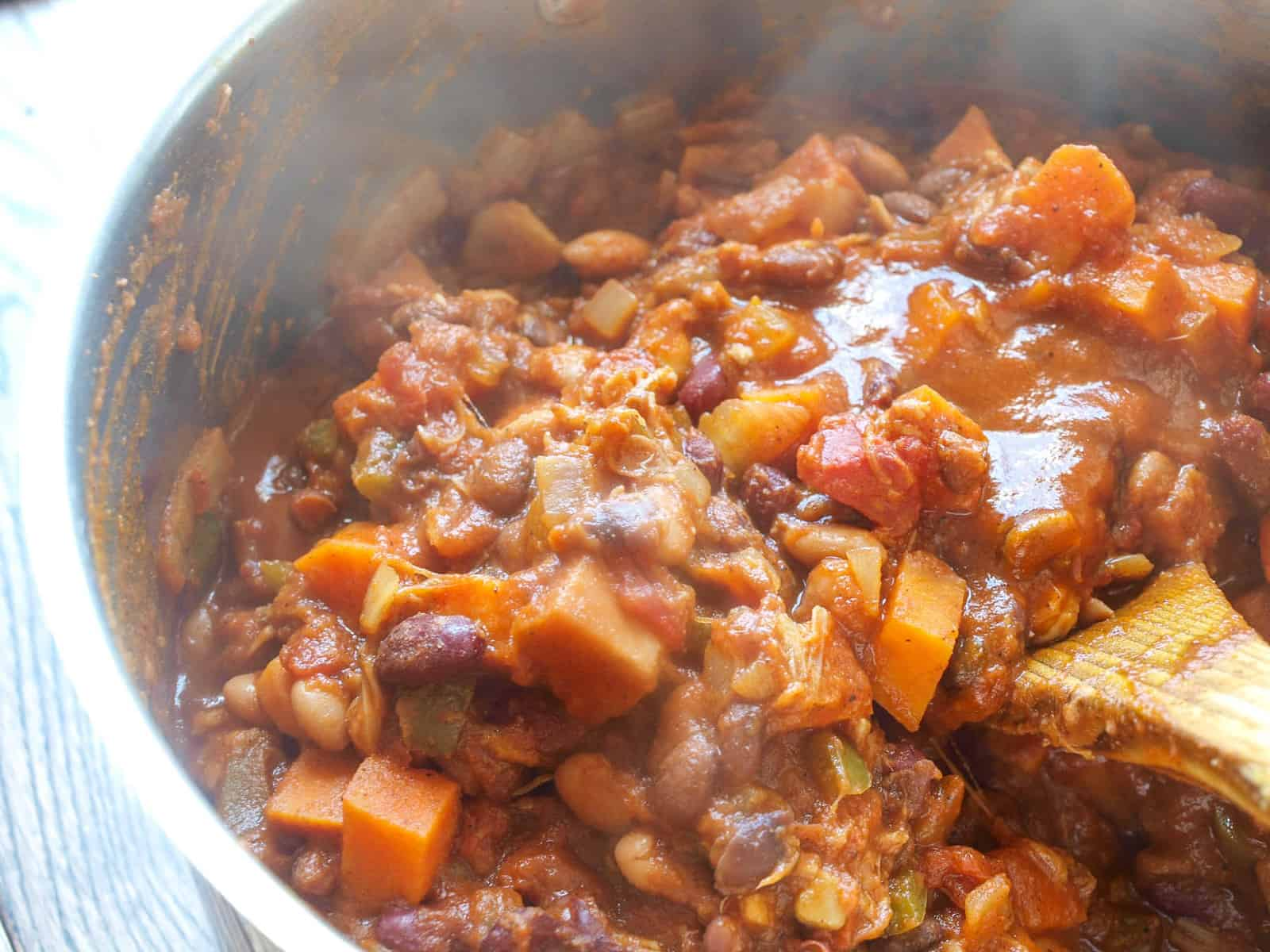 Steam coming off of an up-close shot of jackfruit vegan chili.