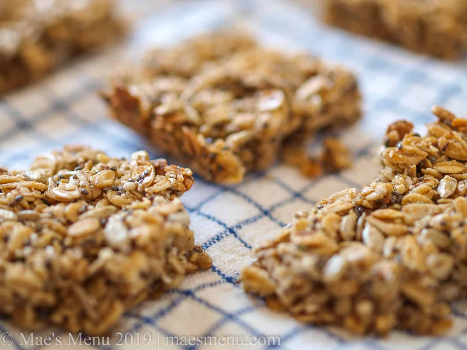 Up-close shot of pumpkin spice granola bars cut into squares-- the perfect healthy fall snack.