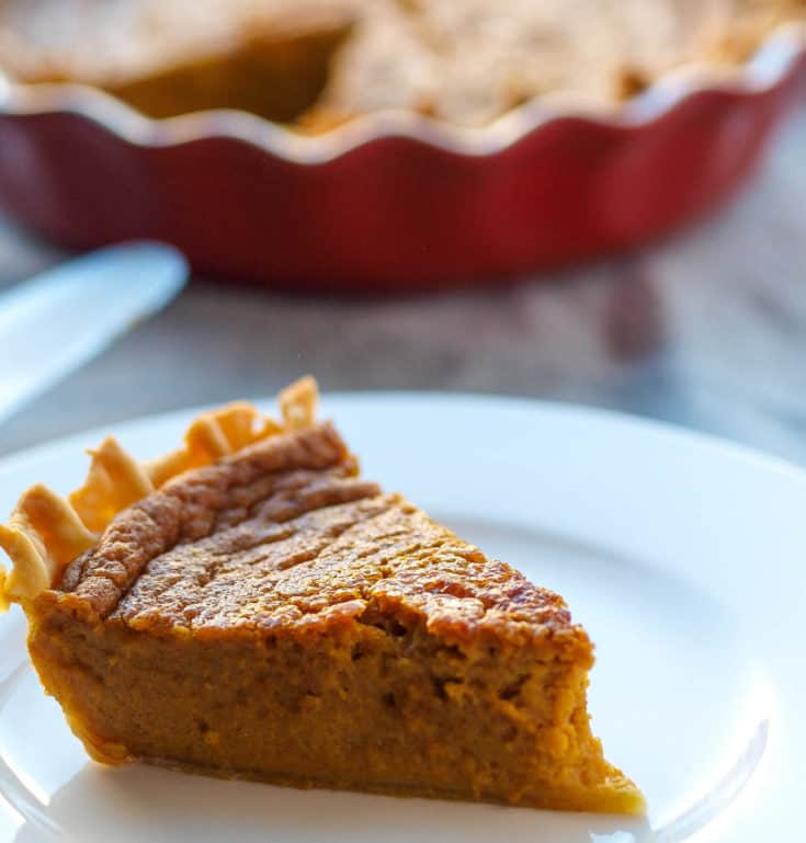 A large slice of gluten-free, dairy-free, and processed sugar free pumpkin pie (with no evaporated milk!)