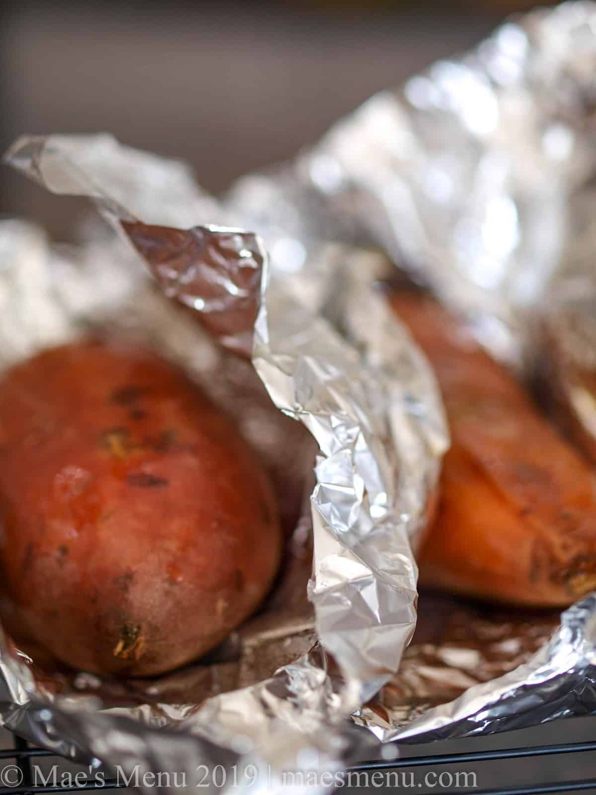 Baked sweet potatoes freshly unwrapped from foil