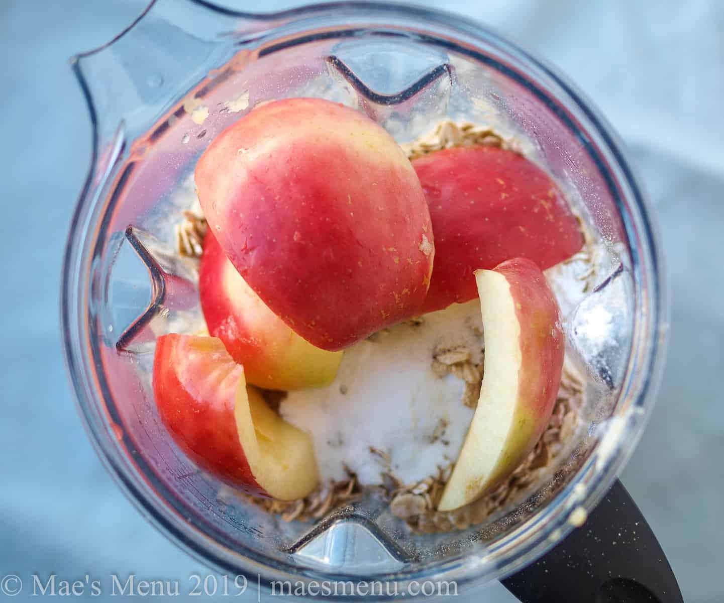 Gluten-free apple blender cake ingredients in a blender pitcher.