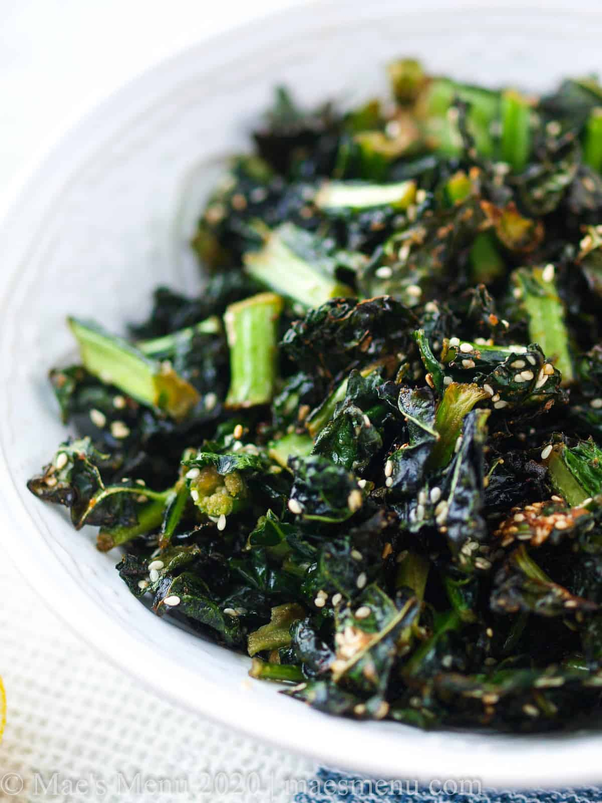 A large bowl of air fryer kale chips with sesame.