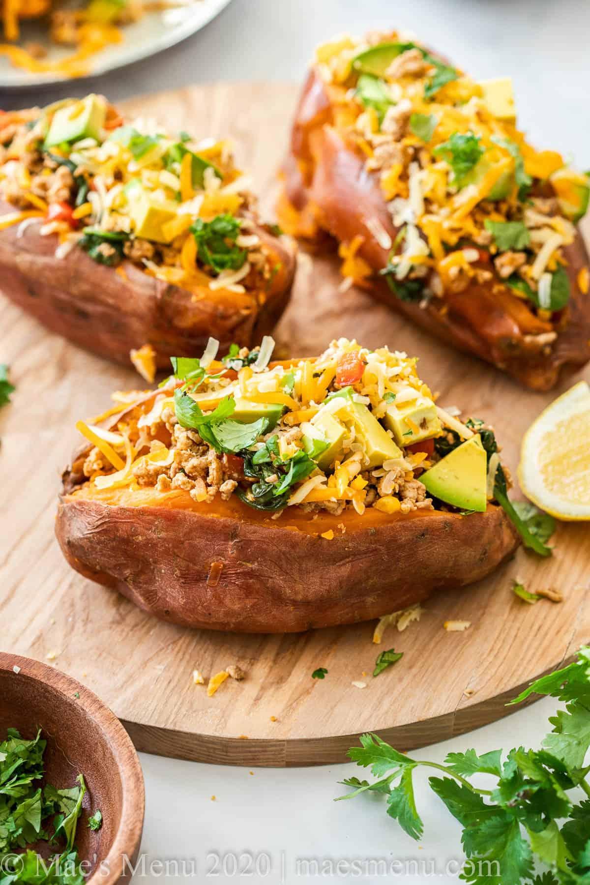 A round platter of taco stuffed sweet potatoes.