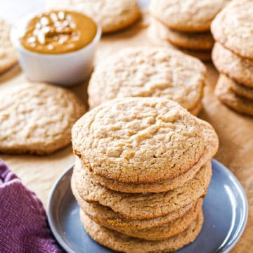 Multiple pies of peanut butter cookies on a wooden table