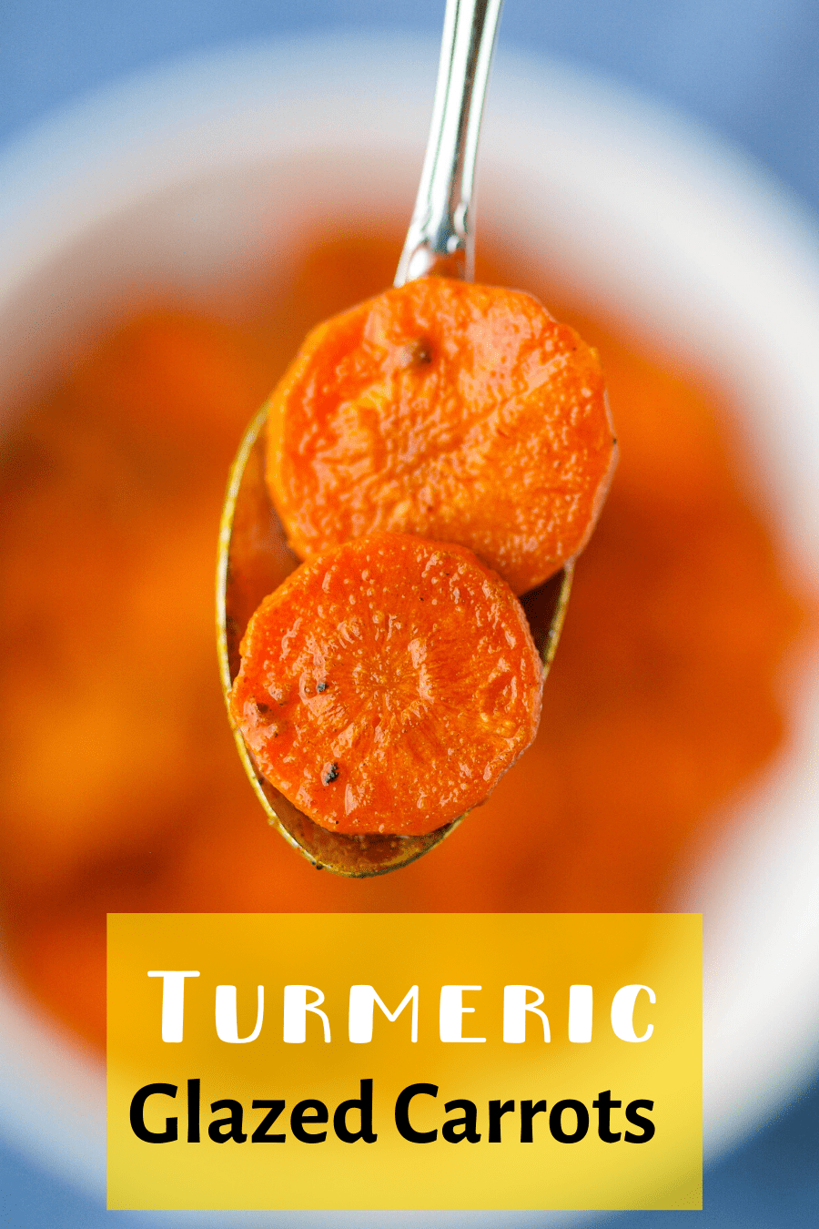 A pinterest pin for honey glazed turmeric carrots with an upclose picture of a spoon with carrots on it.