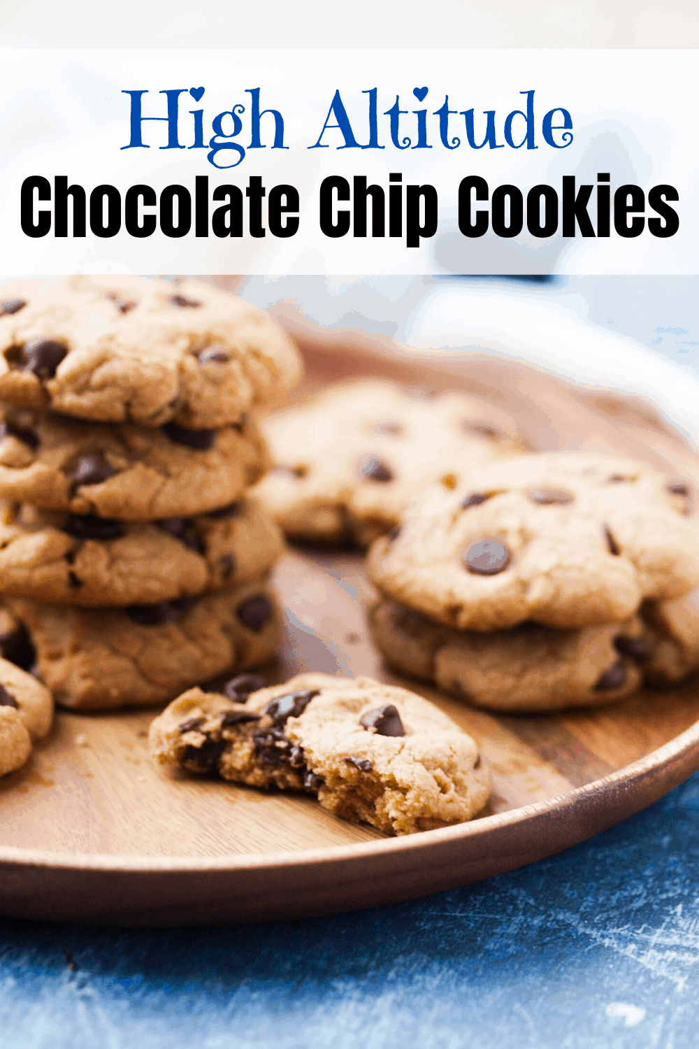 A pinterest pin for high altitude chocolate chip cookies. In the picture is a platter of the cookies.