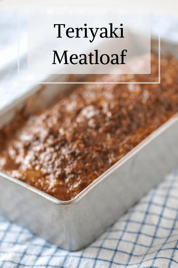 Pinterest pin for teriyaki meatloaf ith a side angel shot of a loaf pan full of meatloaf