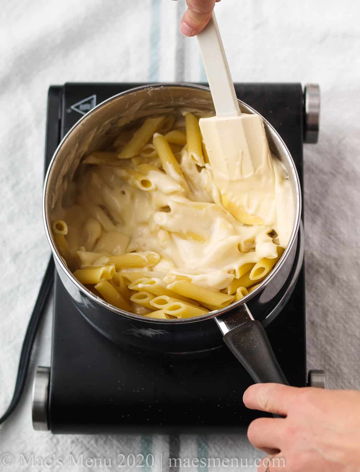 Fold the pasta into the cheese sauce