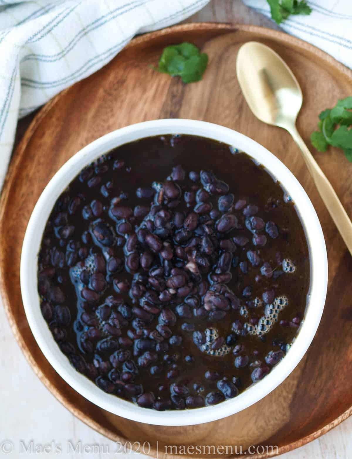 A large bowl of instant pot cuban black beans