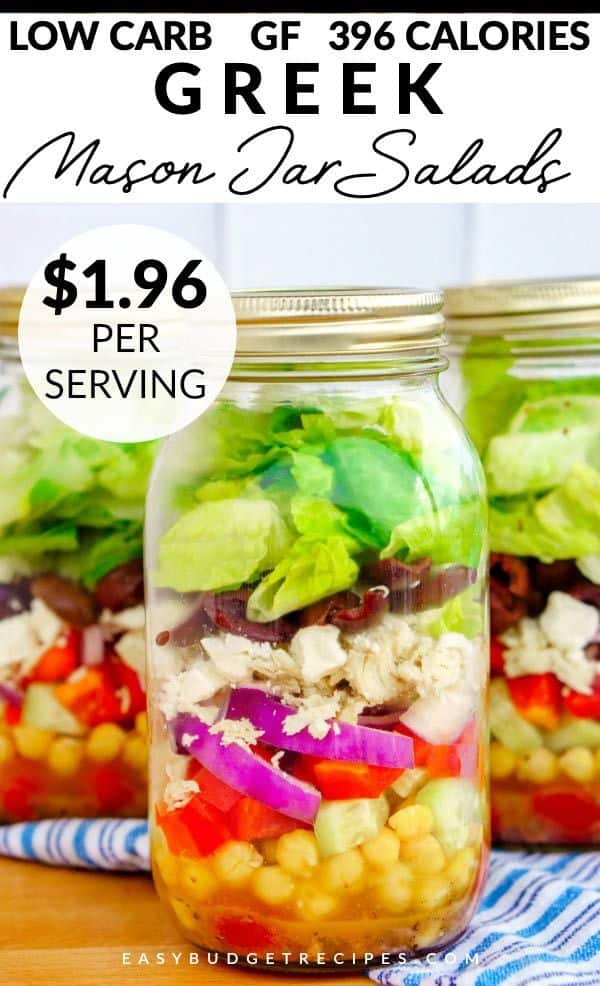 3 greek salad mason jars on a blue and white striped towel. Just $1.9 per serving, 396 calories, and low carbs.