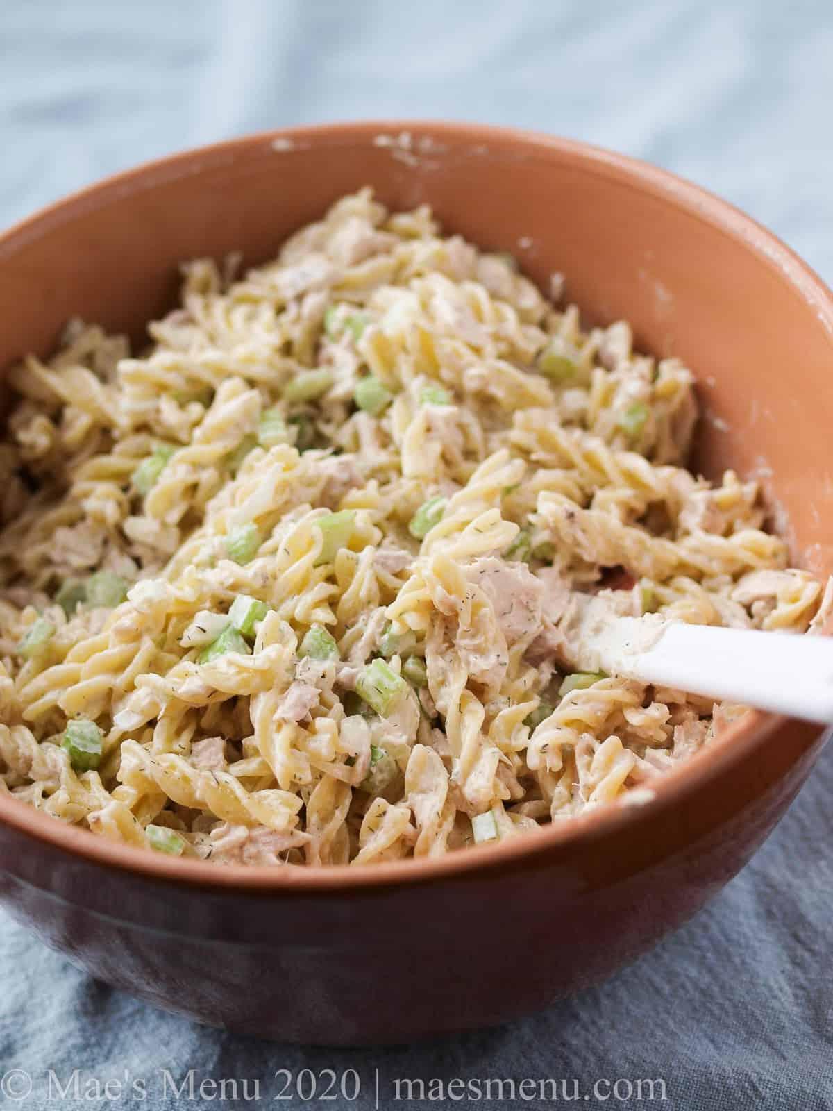 A large mixing bowl full of tuna macaroni salad.
