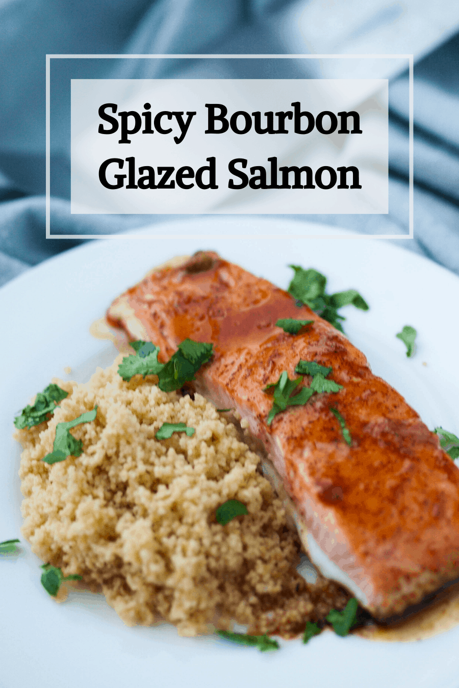 A pinterest pin for spicy bourbon glazed salmon. A plate of salmon and couscous sits in the background.