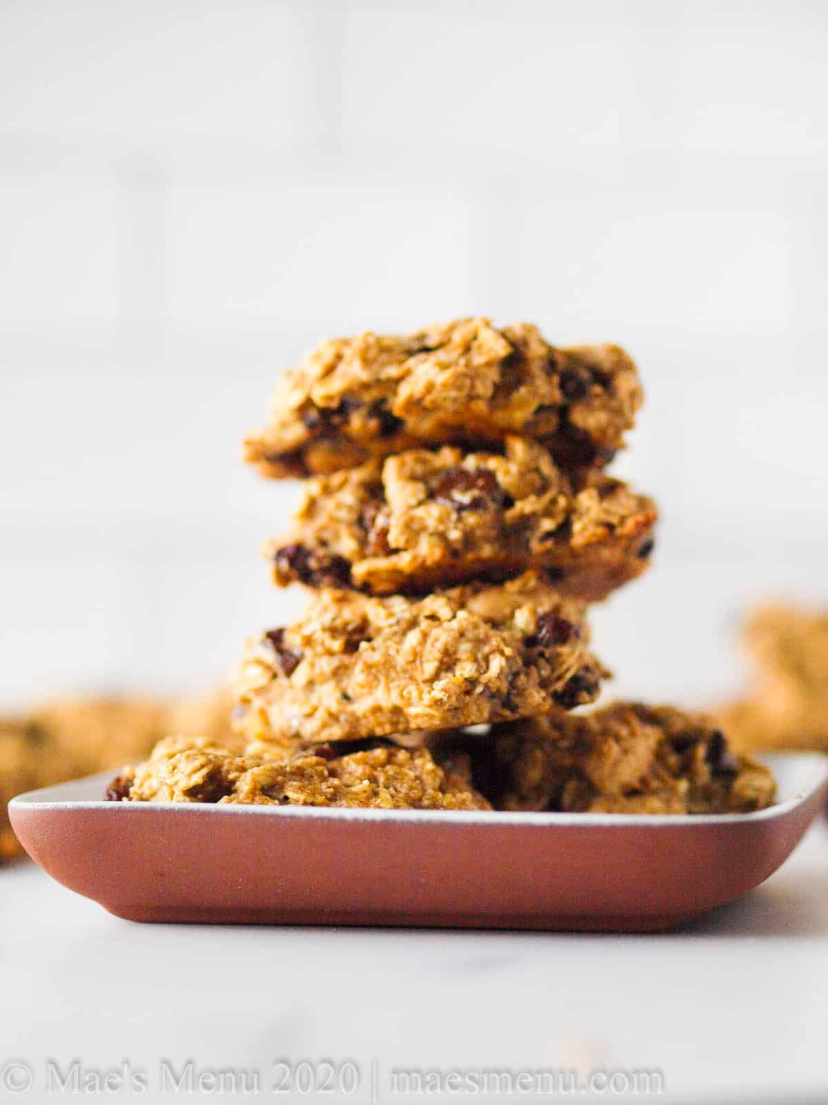 A stack of oat protein cookies on a plate of cookies