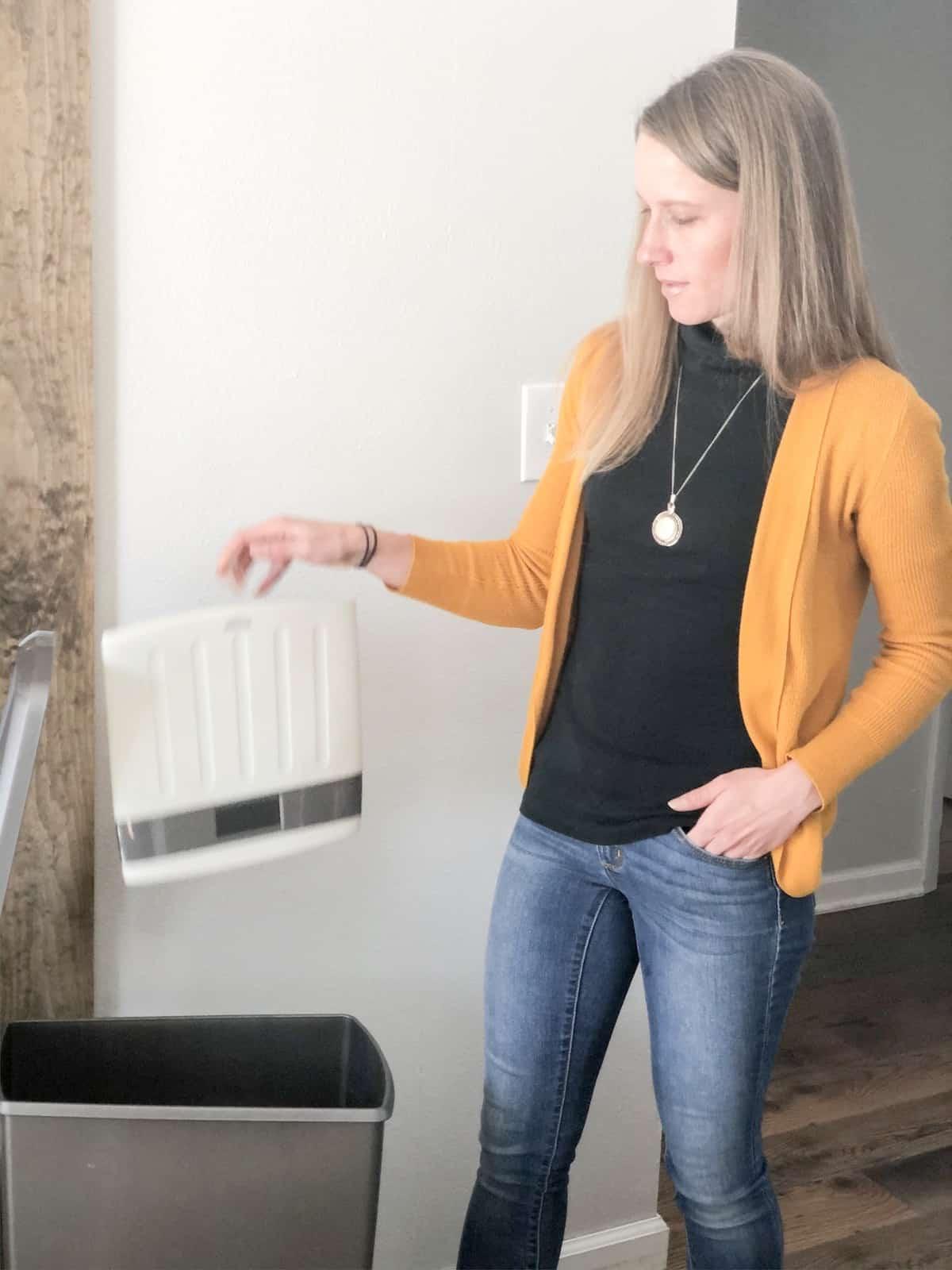Lynn Stiff, of nutritionhealthlife.com, throwing away a scale.