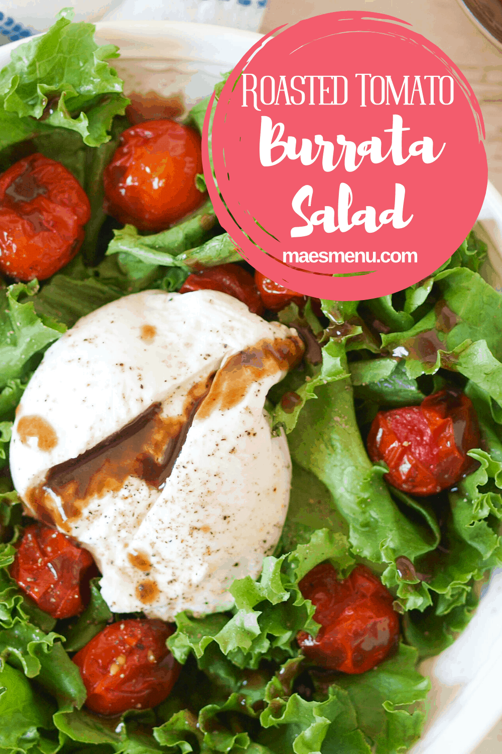 A pinterest pin for roasted tomato burrata salad with an up close picture of the salad and a round blurb in the upper right corner with the title.