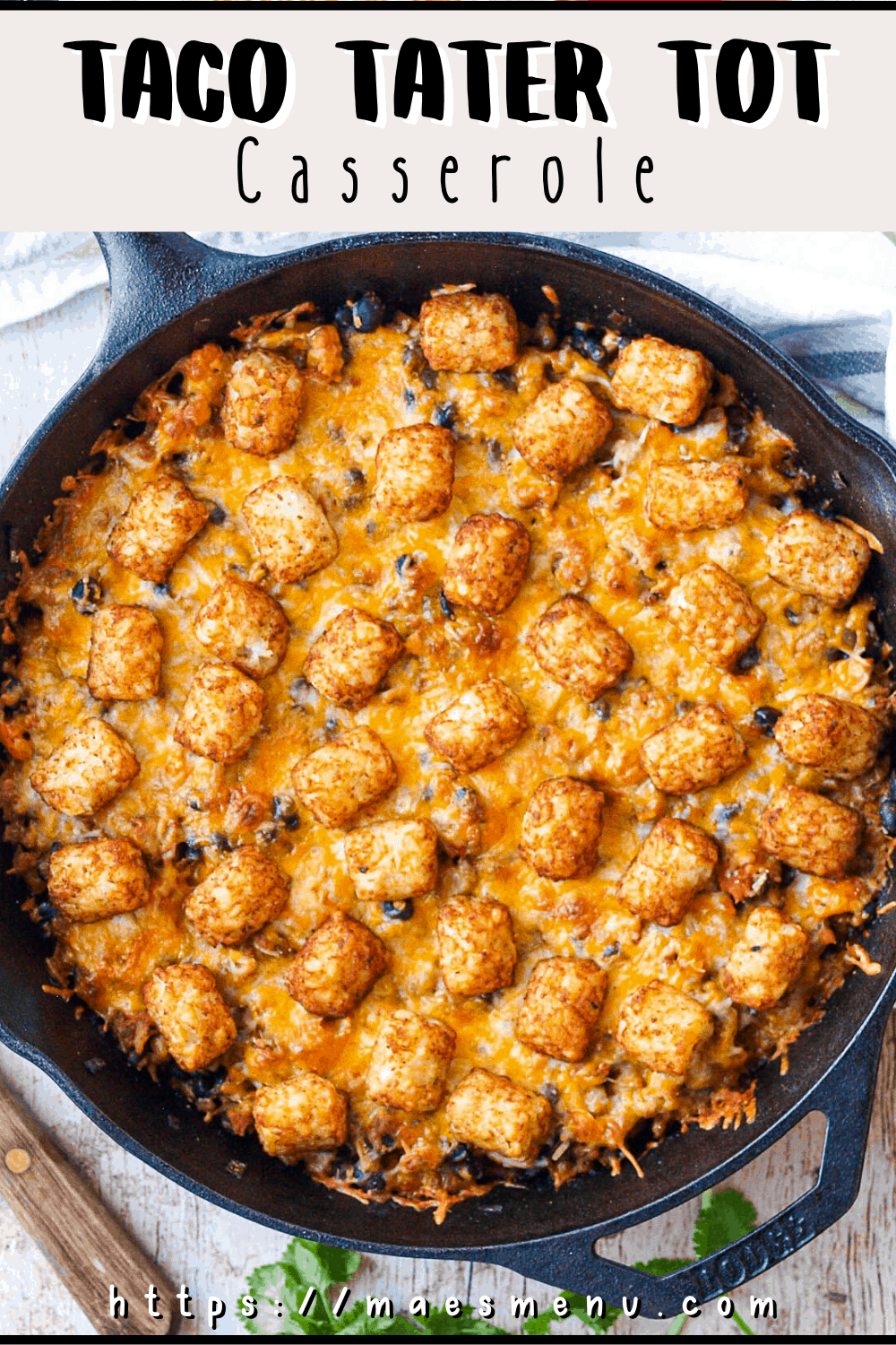Pinterest pin for taco tater tot casserole with an overhead shot of a pan of the casserole.