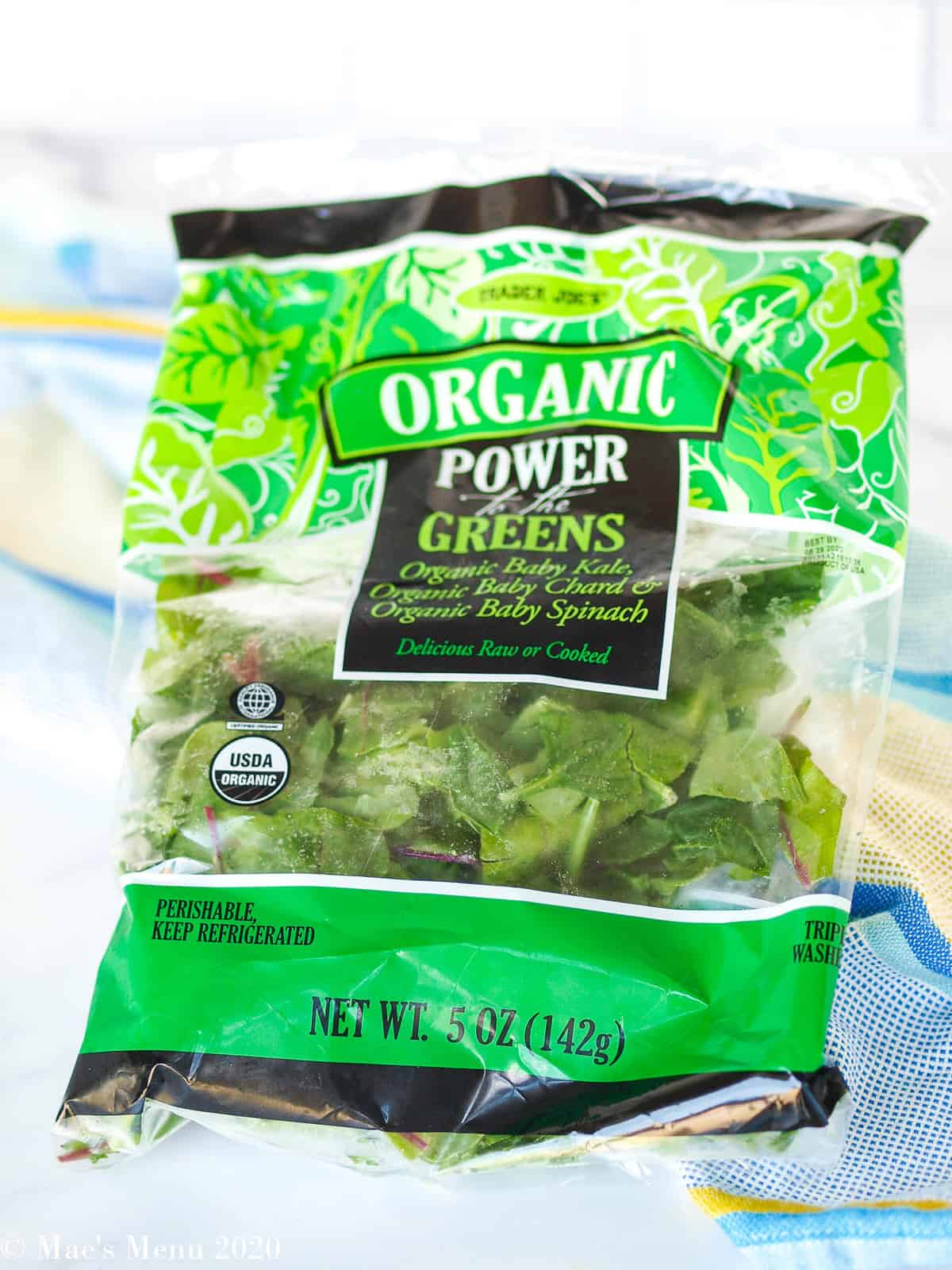 """A bag of Trader Joe's organic """"power of the greens"""" baby lettuce."""