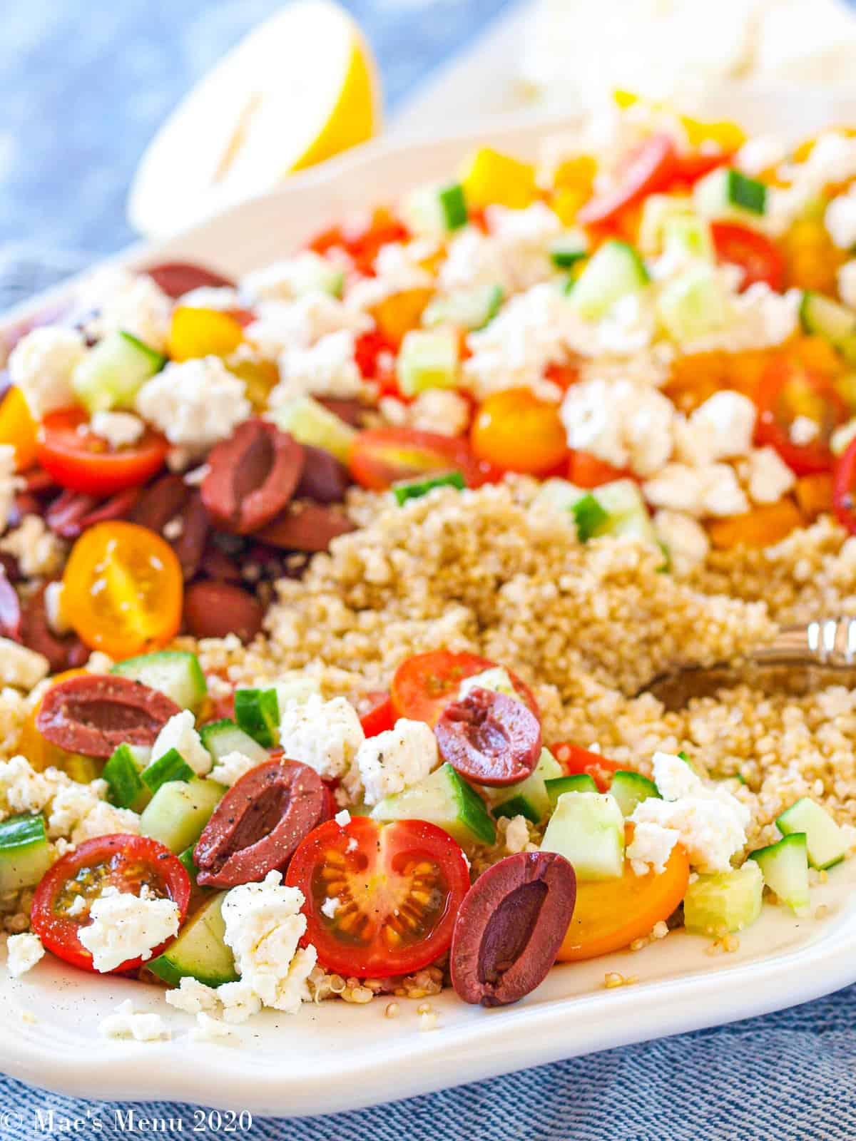 A large white platter of Greek Quinoa salad without dressing.