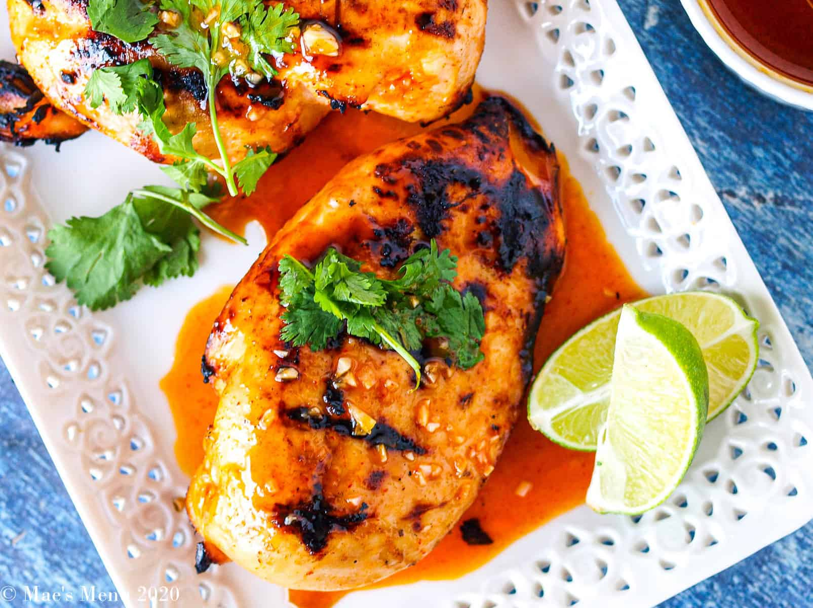 An overhead shot of a grilled chicken breast in the honey spicy chicken marinade.