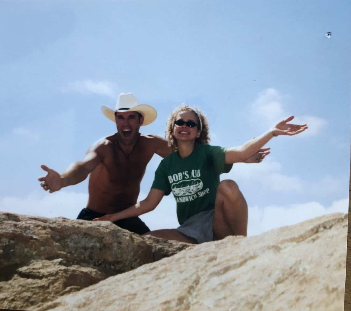 Cousin Kirk and Chelsea on a boulder while hiking.