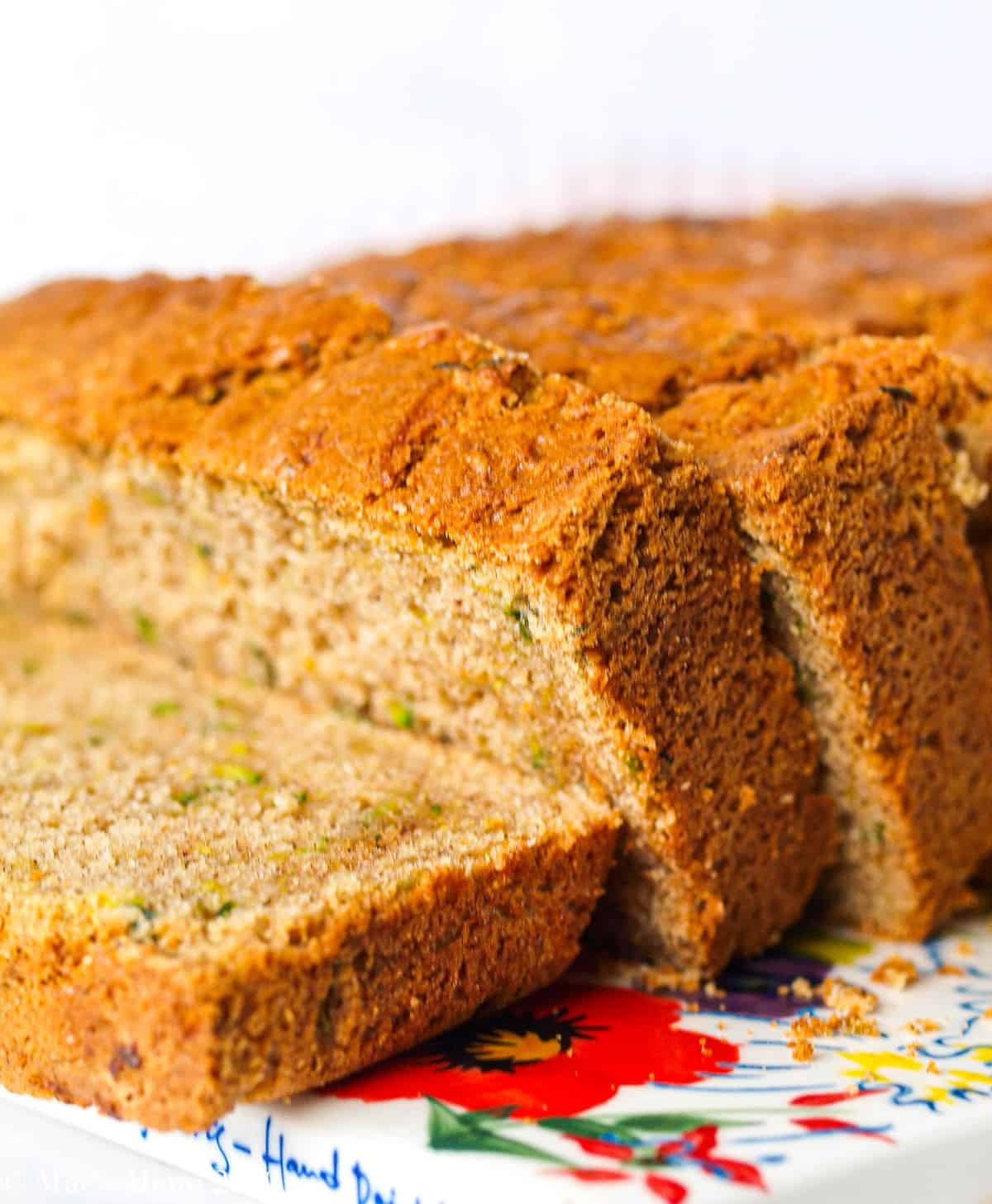 A side shot of zucchini bread slices resting on each other.