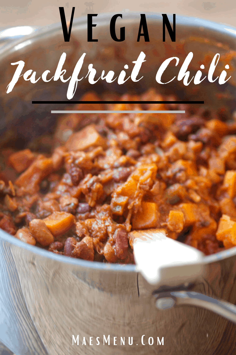 A pinterest pin for vegan jackfruit chili with a picture of a pot of jackfruit chili.