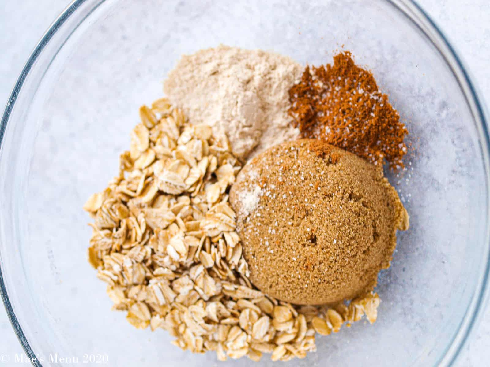 A small bowl of brown sugar, oats, seasonings, for the muffin streusel