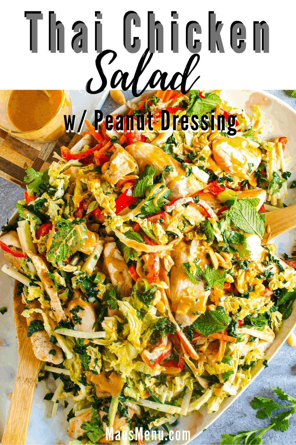 A pinterest pin for thai chicken salad with peanut dressing. The shot is an overhead picture of a large platter of the chopped salad.