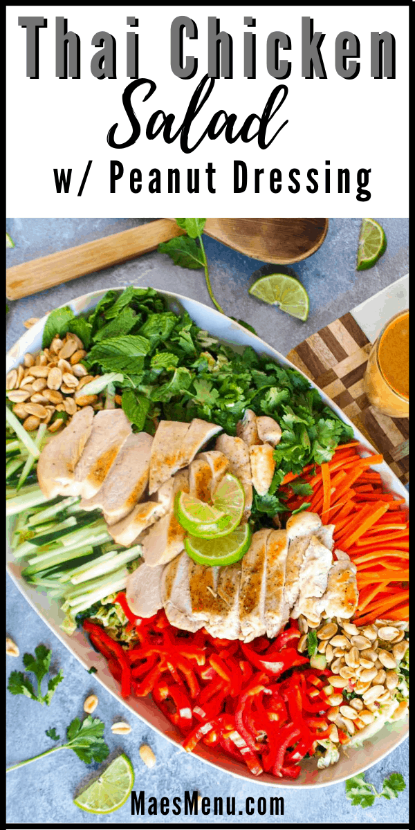 A pinterest pin for Thai chicken salad with peanut dressing. The picture is an overhead shot of a platter of thai chicken salad. next to it is a small cup of peanut butter and salad tongs