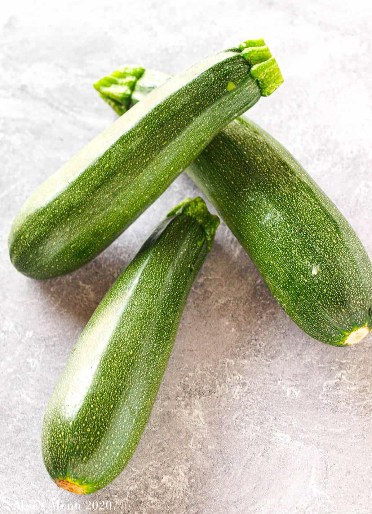 3 medium zucchini resting on eachother