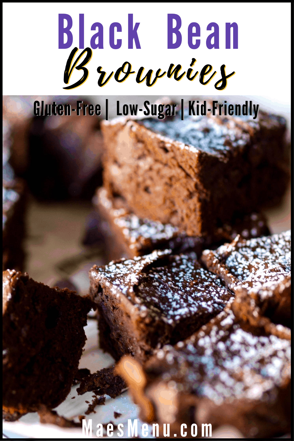 Pinterest pin for black bean brownies. On the picture are piles of the brownies with confectionary sugar on top