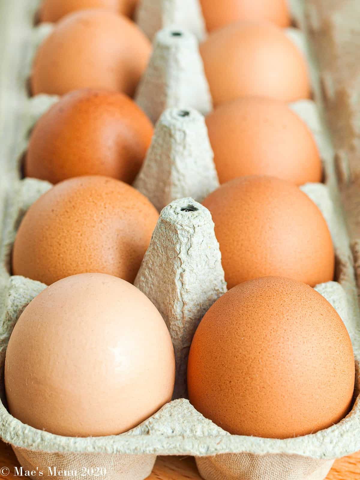 A side angle shot of a crate of brown eggs