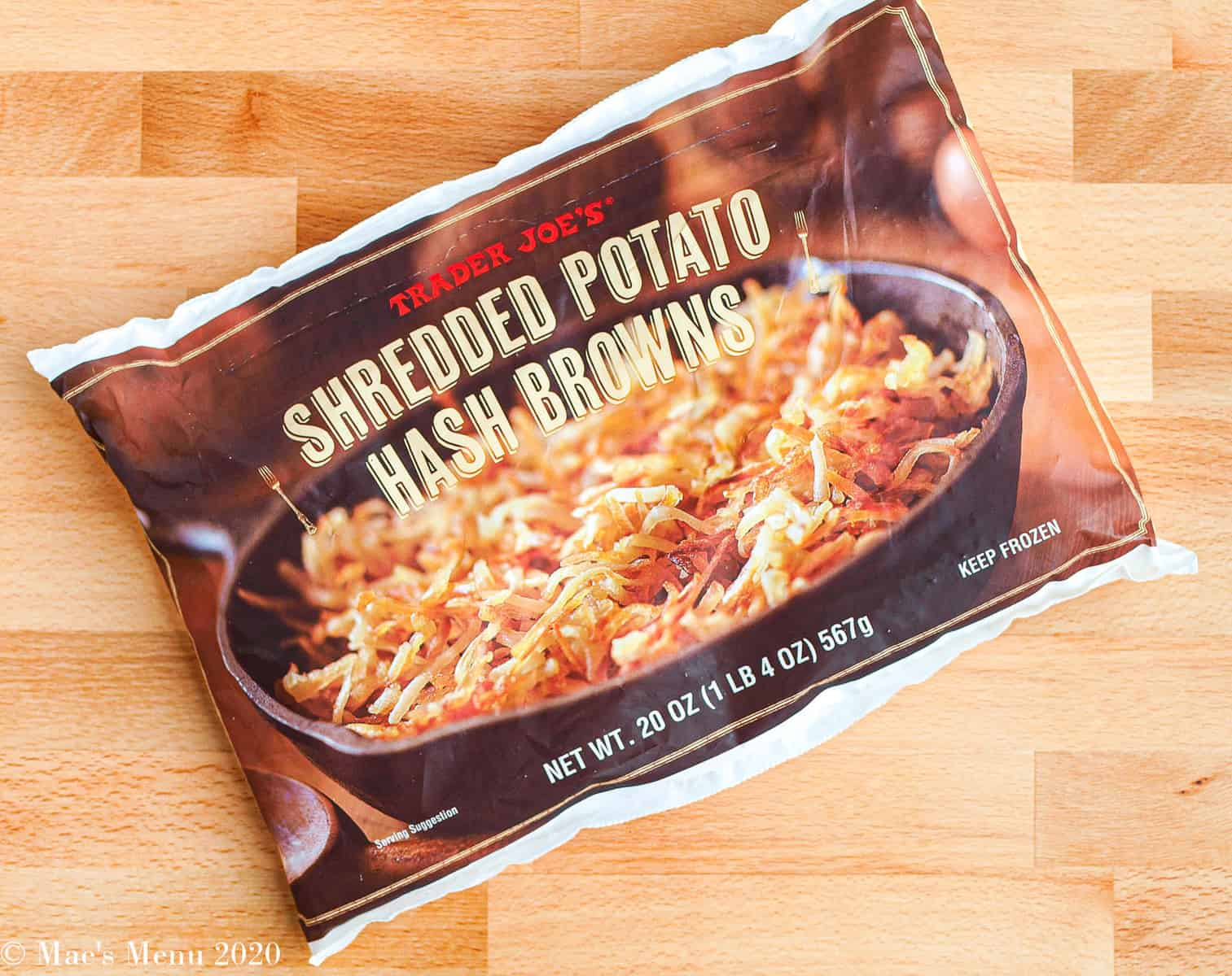 An overhead shot of a bag of Trader Joe's Shredded Potato Hash Browns.