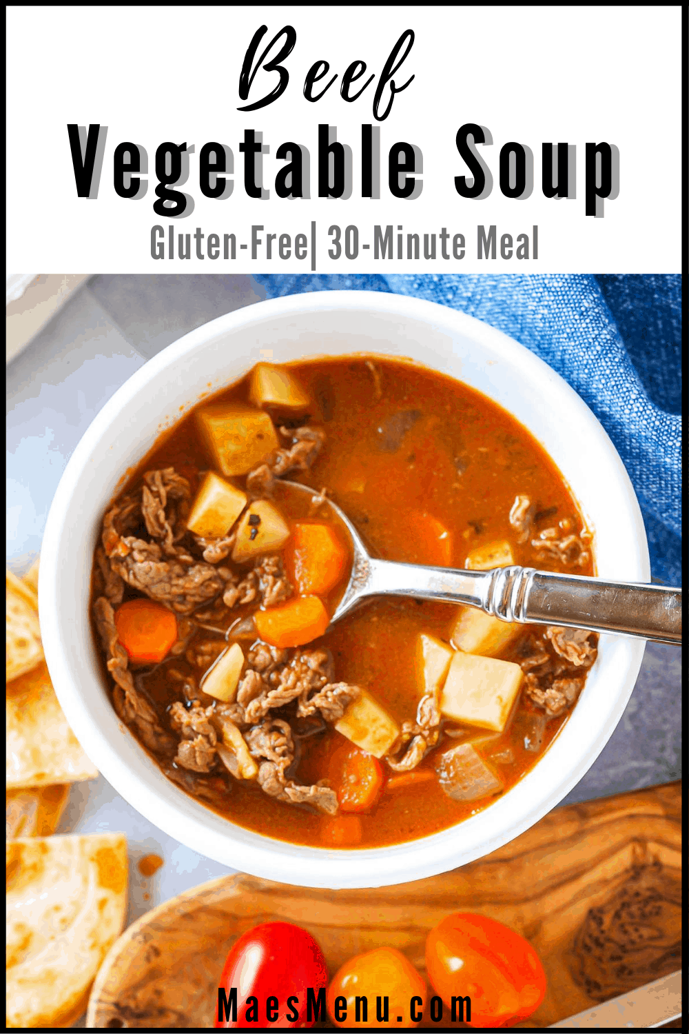 Pinterest pin for beef vegetable soup with an overhead shot of a bowl of the soup with a large spoon in the bowl