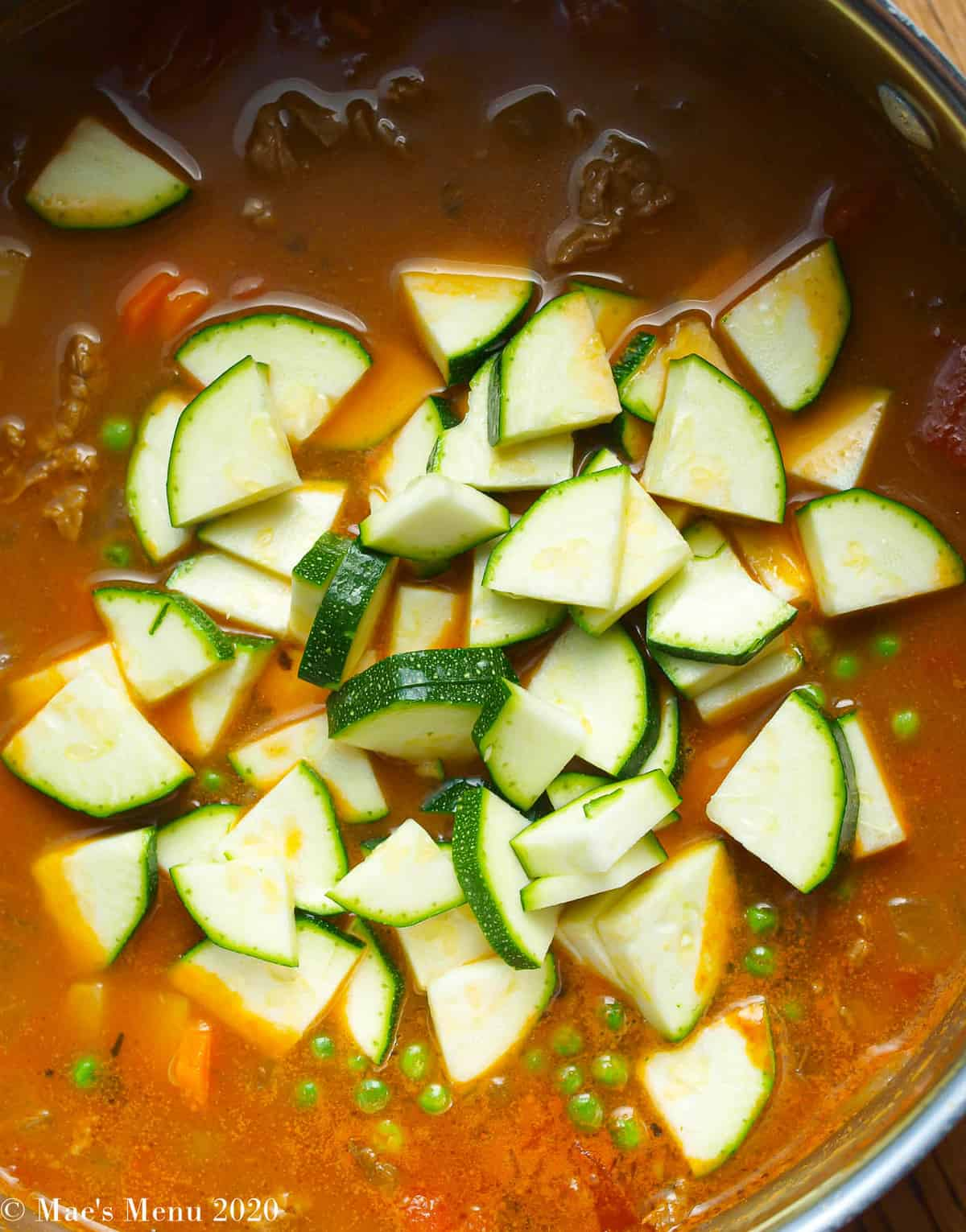 Adding zucchini to the pot