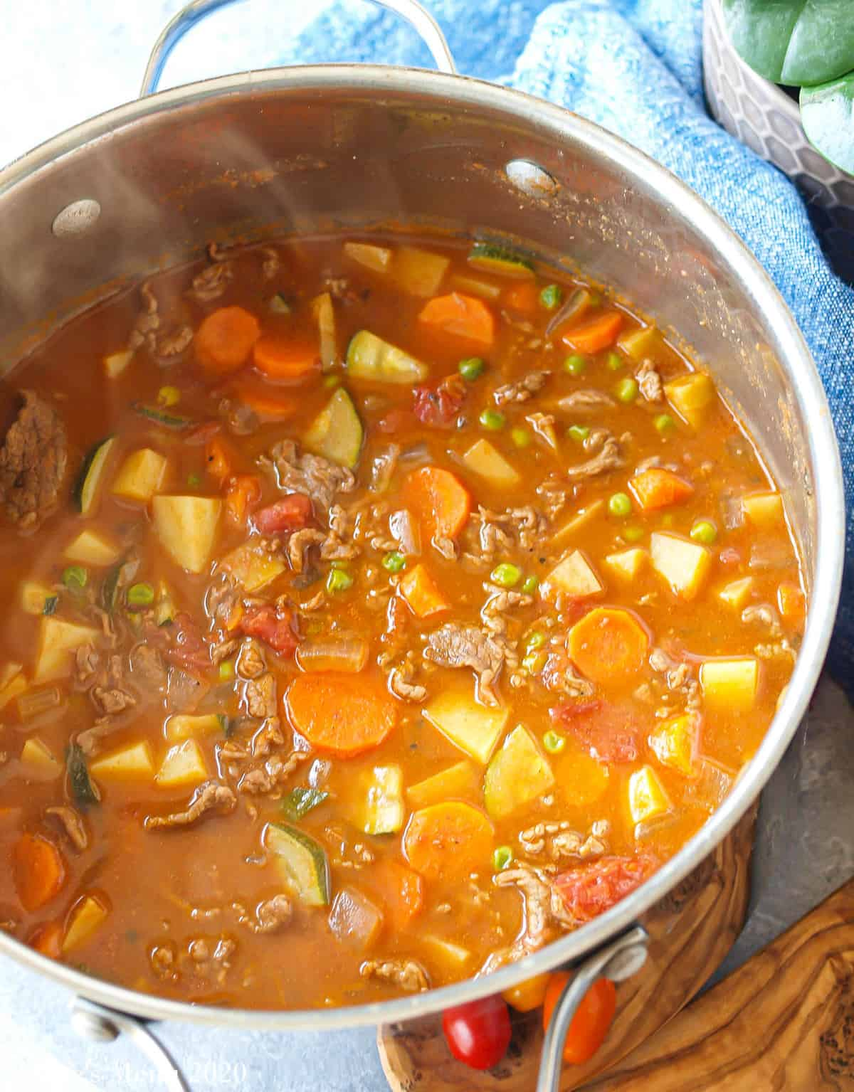 Freshly cooked steak soup in a large pot