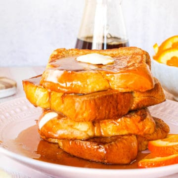 An up-close shot of a large stack of brioche french toast
